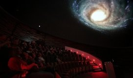 The HdA's central auditorium is equipped with a digital planetarium system. Here, visitors can take virtual journeys into space - in this example, in September 2012, we have travelled outside our Milky Way galaxy and are looking back. The planetarium also allows for the projection of astronomical images and visualizations. Image: HdA/M. Pössel