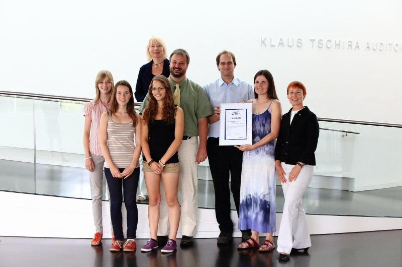 "Prizegiving ceremony for the competition ""Energy for Education"" on July 19, 2013 at Haus der Astronomie. From the left: Katrin Geng and Hannah Fischer, participants of the 2013 astronomy course at JuniorAkademie Baden-Württemberg, student tutor Ronja Geppert, JuniorAkademie leaders Petra Zachmann (back) and Georg Wilke, Dominik Elsässer and Carolin Liefke as well as Angela Grether from the company GasVersorgung Süddeutschland."
